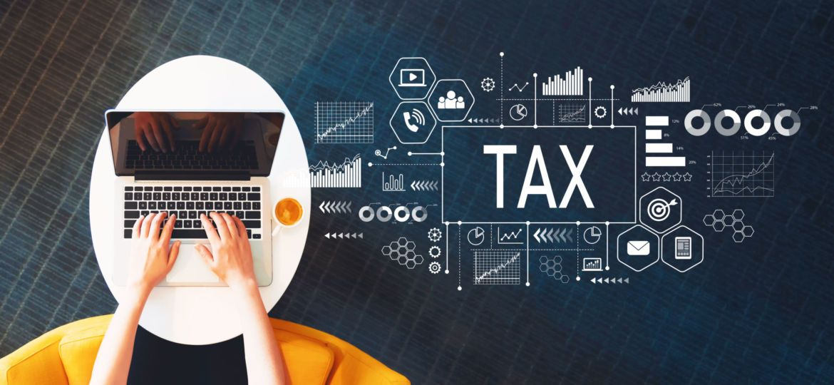 Tax with person using a laptop